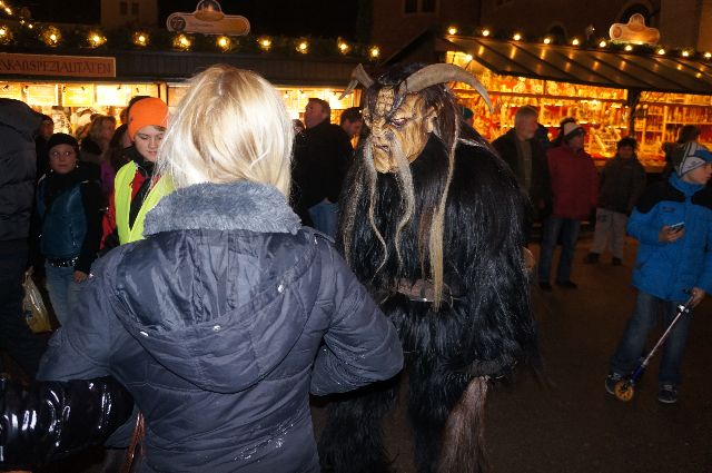 Salzburg Krampus with girl Christmas in Austria: How Naughty Children Should Be Dealt With   The Krampus