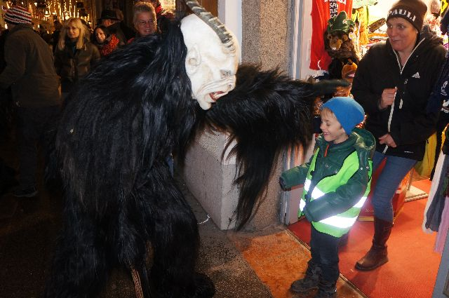 krampus petting Christmas in Austria: How Naughty Children Should Be Dealt With   The Krampus